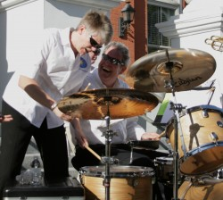 Two men with a drum set